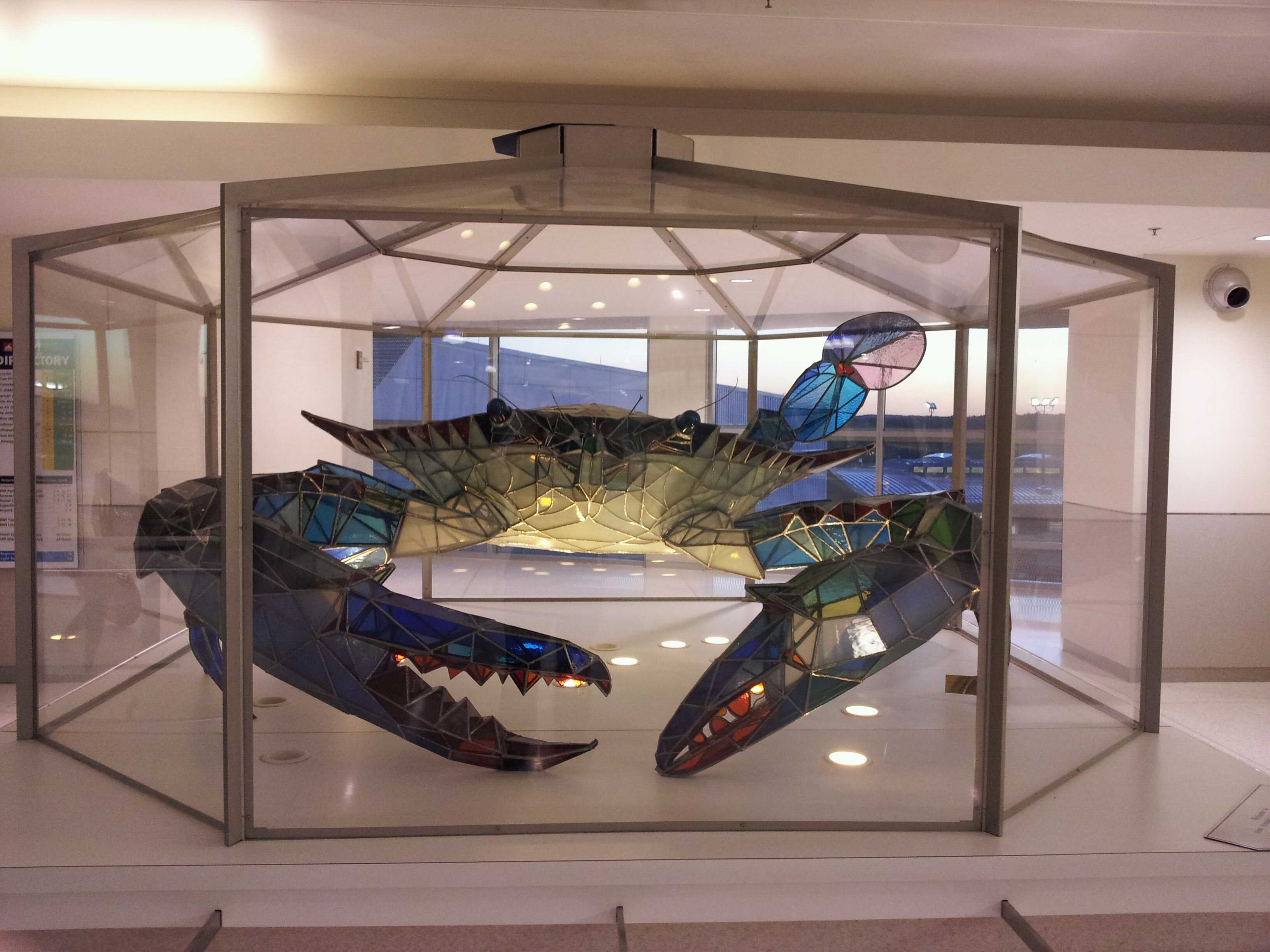 A very large stained glass blue crab.