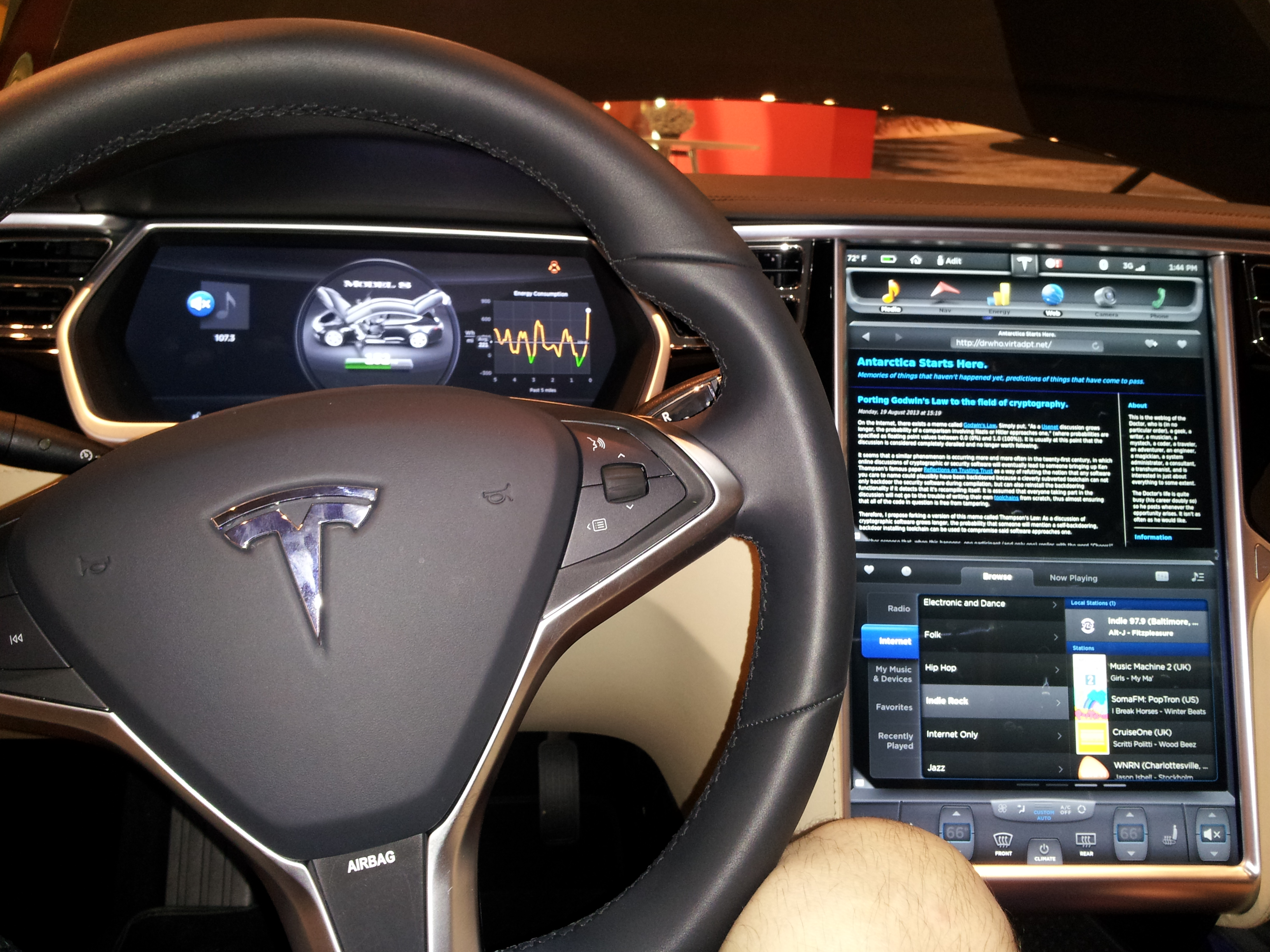 Sitting in the driver's seat of a Tesla.